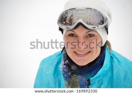 young beautiful woman wearing ski glasses