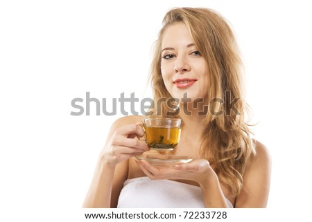Young beautiful woman with a cup of green tea against white background