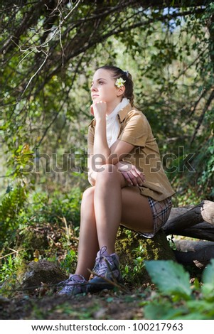 young beautiful woman with a flower on the ear, outdoors