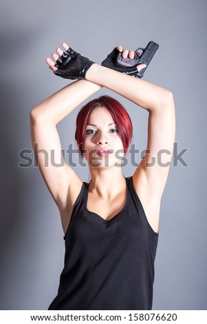 young beautiful woman with a gun