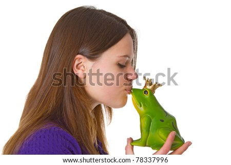 Young beautiful woman with a toy frog prince on white background.