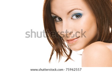 Young beautiful woman with bared shoulders smiles, on white background.