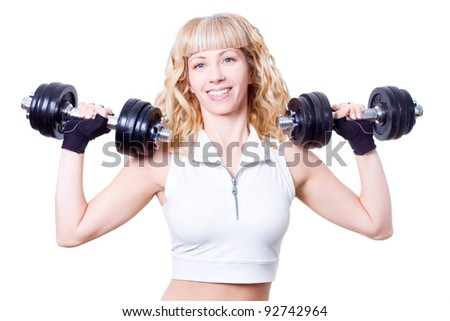 young beautiful woman with black dumbbells in hands