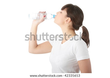 Young beautiful woman with bottle of mineral water, isolated on white background