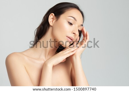 Young beautiful woman with clean perfect skin close-up.  Beauty, youth, skin care #1500897740