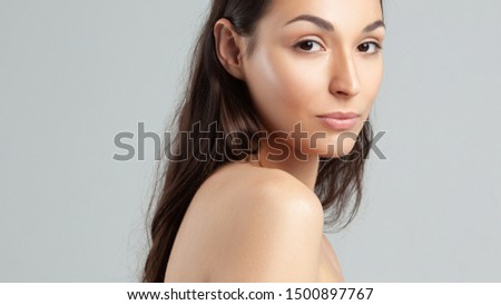 Young beautiful woman with clean perfect skin close-up.  Beauty, youth, skin care #1500897767