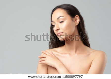 Young beautiful woman with clean perfect skin close-up.  Beauty, youth, skin care #1500897797
