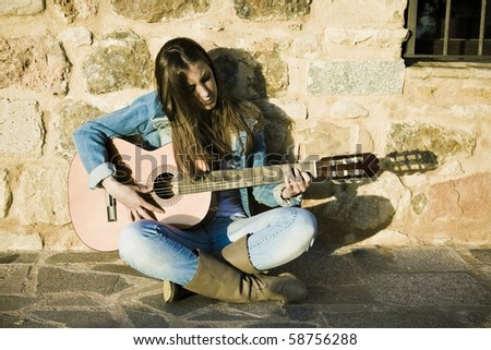 Young beautiful woman, with his classical guitar