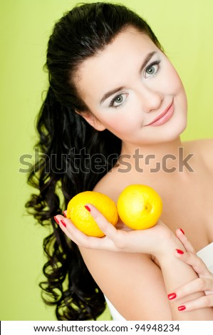 young beautiful woman with lemon