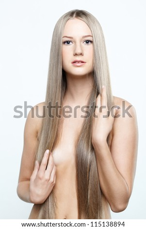 Young beautiful woman with long blond hairs