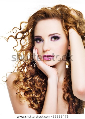 Young beautiful  woman with  long curly hairs - isolated on white - stock photo