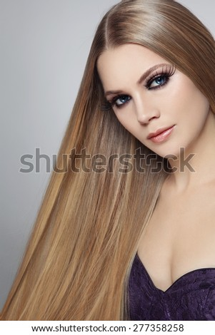 Young beautiful woman with long hair and false eyelashes #277358258