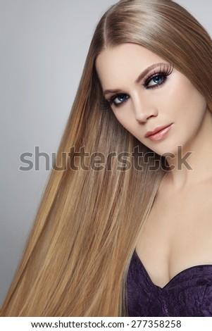 Young beautiful woman with long hair and false eyelashes #277358258