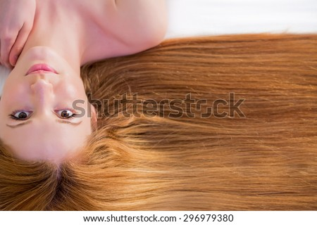 Young beautiful woman with long hair on white background