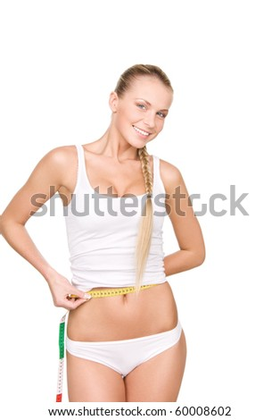 young beautiful woman with measure tape over white