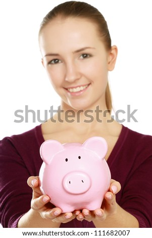 Young beautiful woman with piggy bank (money box), isolated on grey background