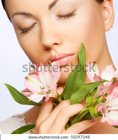 young beautiful woman with  pink flower