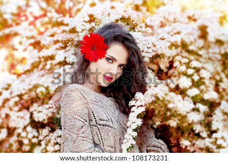 young beautiful woman with red flower