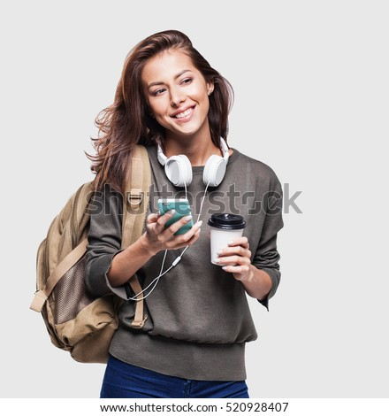 Young beautiful woman with smart phone