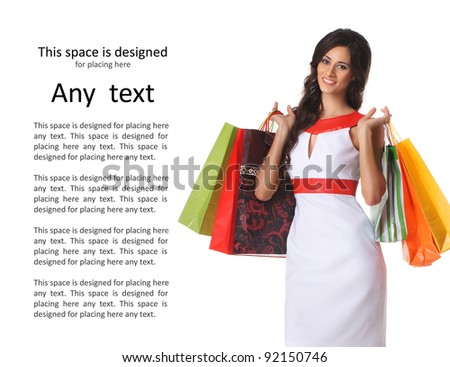 Young beautiful woman with some shopping bags isolated on white