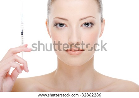 young beautiful woman with syringe in her hand - white background