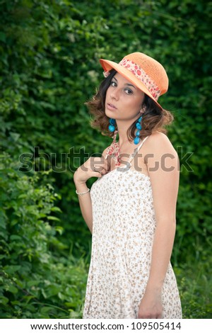 Young beautiful woman with white dress and hat.