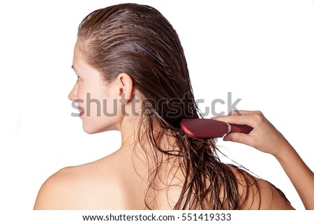 Young beautiful woman with white towel and freckles combing her brown wet hair after showering. studio shot. isolated on white background. #551419333