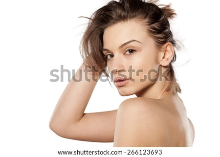 young beautiful woman without make-up on a white background