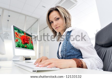 young beautiful woman working at the office