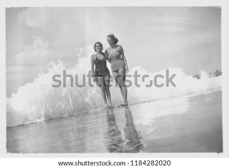 Young beautiful women by the sea, 1950
