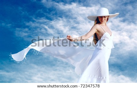 Young beautiful women in the white with pareo on the blue sky background