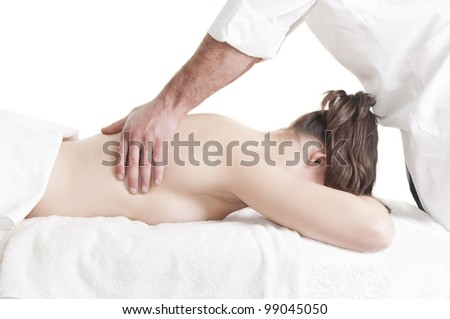 Young beautiful young woman receiving back massage at spa