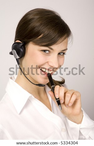 Young beauty girl with laptop. VoIP. Call center. Helpdesk.