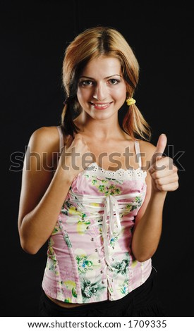 Young beauty showing thumb up sign - black background - very high resolution