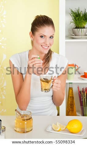 Young, beauty woman drinking a cup of tee