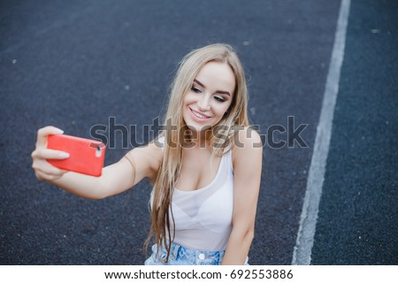 young beauty woman make selfie for self smartphone, outdoor portrait, fashion model, pretty girl, hipster, lips red, make up, close up, beauty street photo, blonde hair, street photo