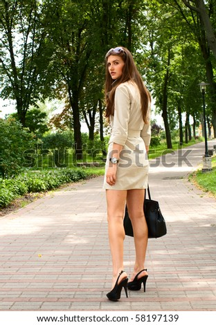 young beauty woman summer city portrait