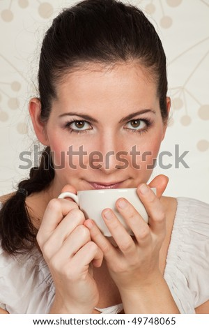Young beauty woman with a cup