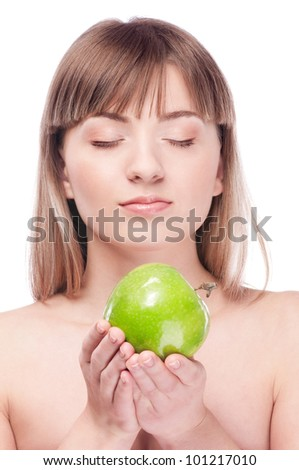 Young beauty woman with green apple isolated on white