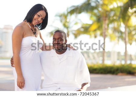 Young bi-racial couple in the park