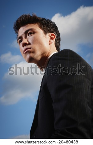 Young biracial businessman standing before a California landscape