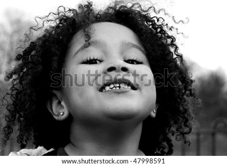 Young black baby girl with curly hair