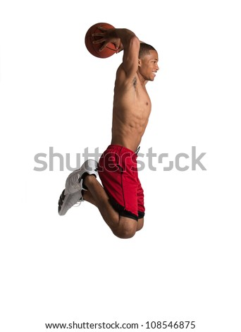 Young Black College Student Jump Slam Dunk Basket Ball on Isolated White Background