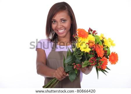 young black female florist taking a flowers bouquet