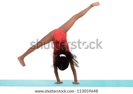 Young black girl doing gymnastics cartwheel motion blur - stock photoGymnastics Silhouette Cartwheel