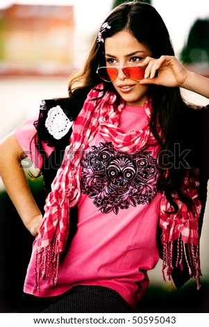 young black hair woman in cool pink clothes, outdoor shot