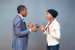 young black man and lady dressed in corporate having an argument