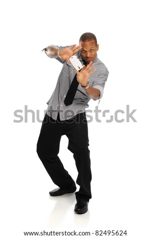 Young Black Man holding a cell phone isolated on a white background - stock photo