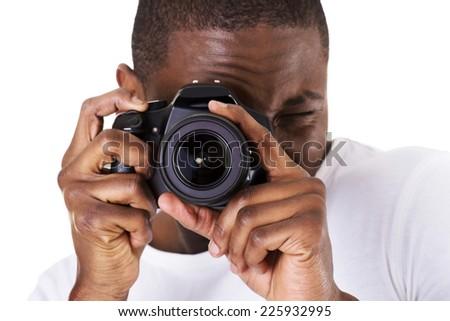 Young black man photographer doing photos