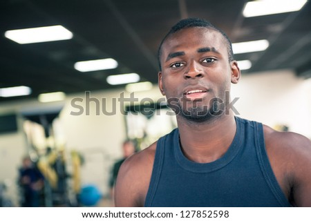 Young black man portrait in the gym.